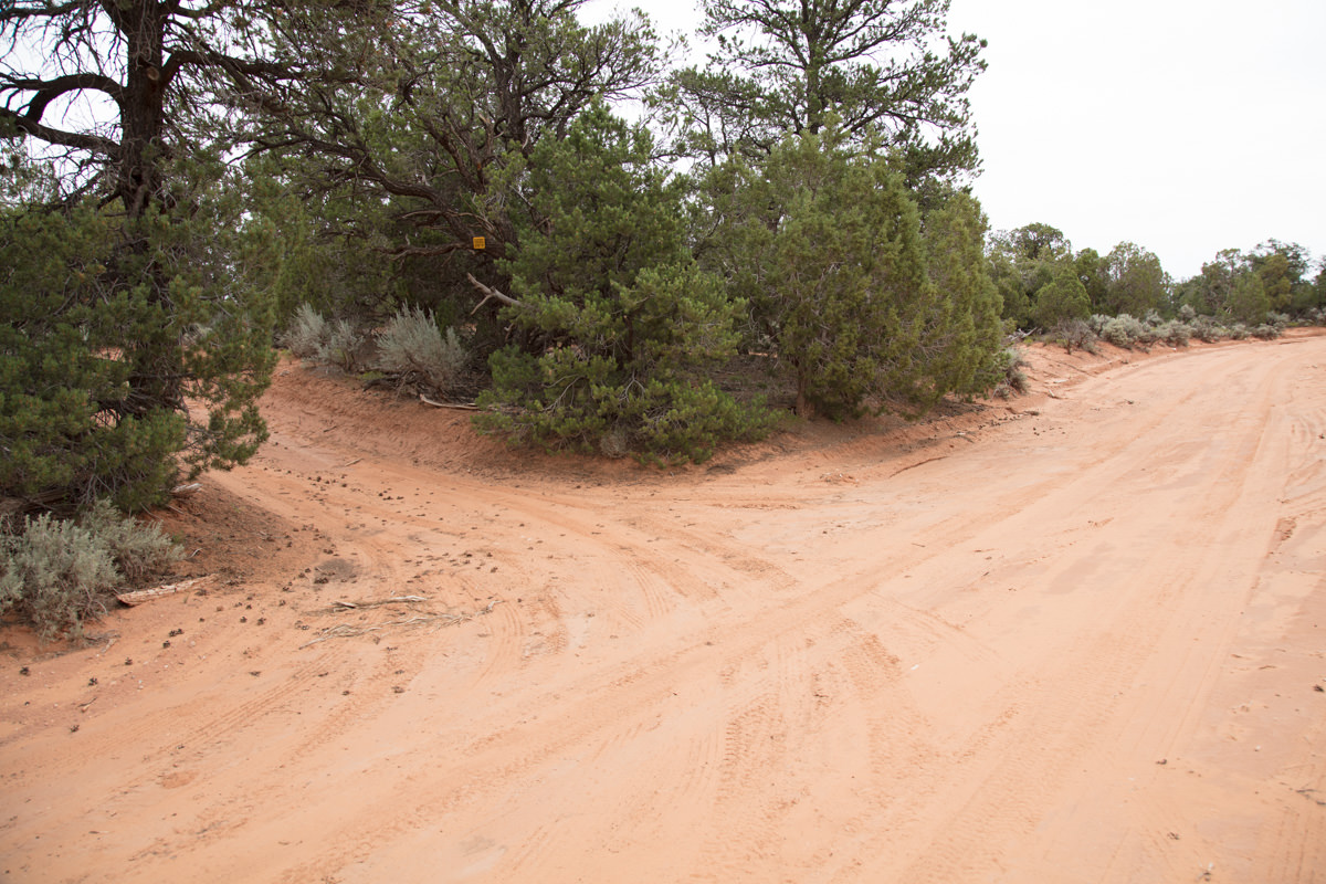 Look for small dirt road on left