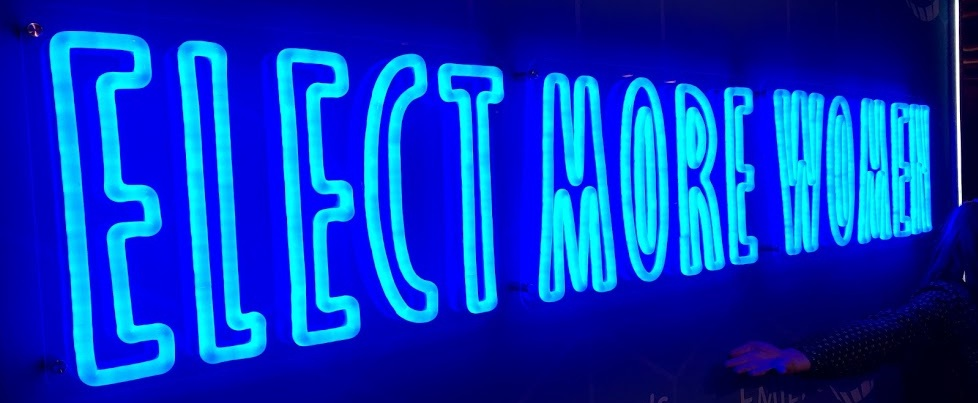 """A neon sign reading """"Elect More Women"""" from the 2019 Emily's List gala"""