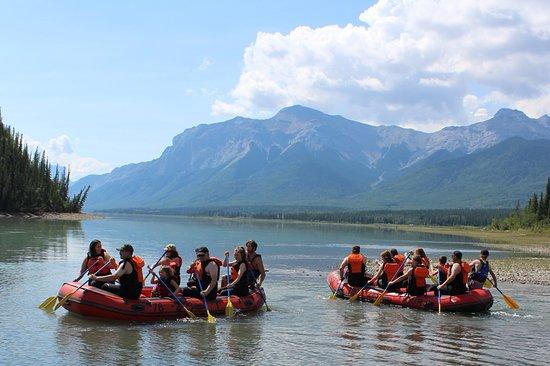 2 Groups of people Rafting in Shadow of Rockies