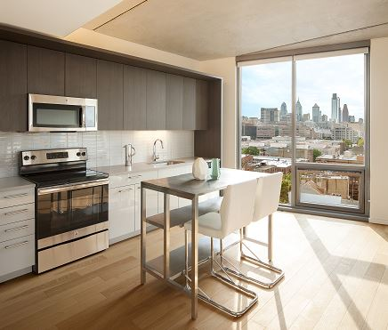 5 Kitchen with Island and Skyline View.JPG
