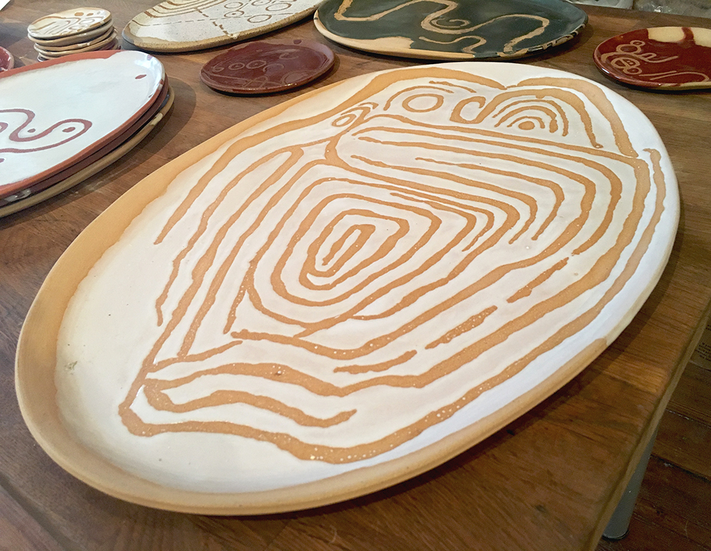 large platter: owl calendar neolithic petroglyph in white on blush clay