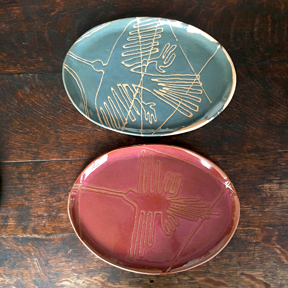 custom small plates with nazca lines (peru) in moss on blush clay & plum on red clay