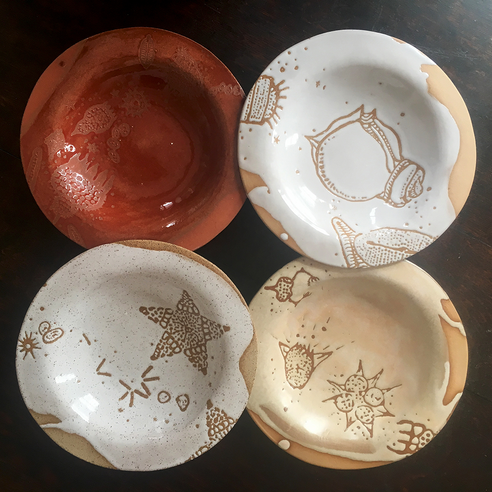 Low bowls in plum on red clay, white on blush clay, créme brûlée on blush clay and white on speckle clay