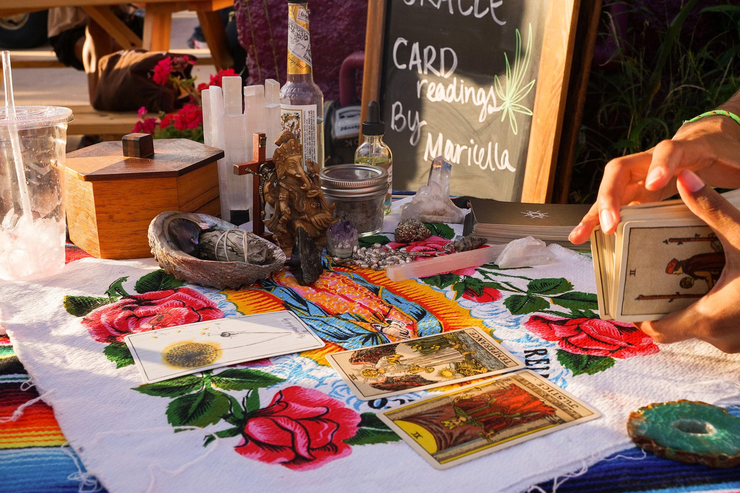 Oracle Card Readings at Bota Gala Night Market by Maricella Nayeri. Photograph by Charlie and Taylor Photography.