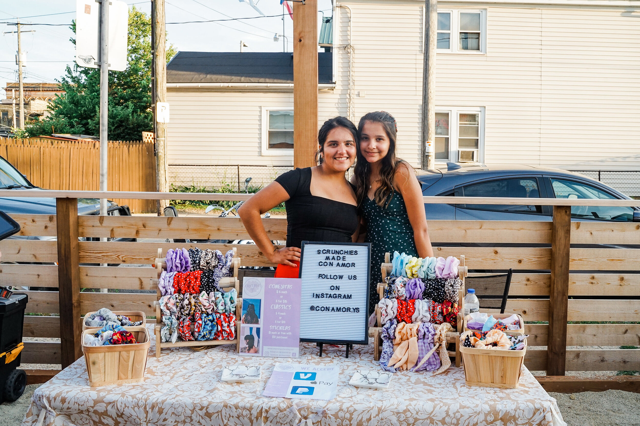 Sister vendors from Con Amor, Y.S. at Bota Gala Night Market. Photo by Charlie and Taylor Photography