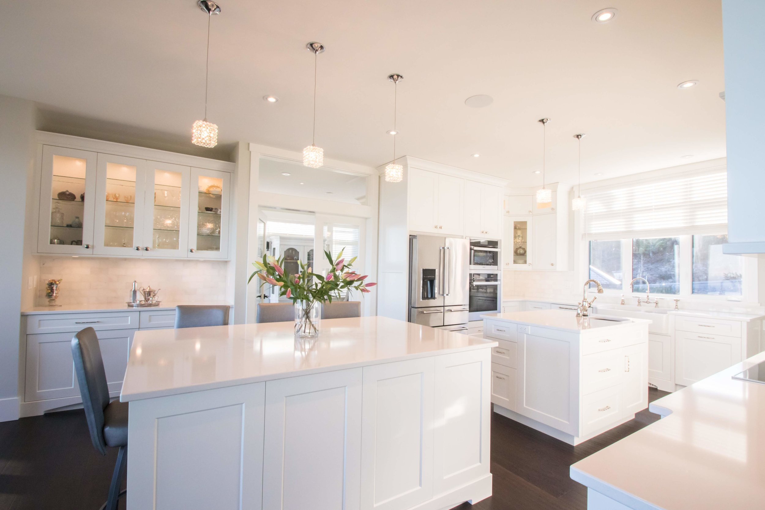 M. Easton - (Client)Project Date: August 2018, Project Price: more than $100,000Having just settled in to our new home, I am pleased to say that the Cowichan Woodwork team skillfully mastered the custom designs, production and installation of all the built-in cabinetry throughout the project. From our experience, Cowichan Woodwork is an honest company that seems to pride itself on the exceptional quality of their products and craftsmanship, their attention to detail and strong work ethic. The staff are friendly, professional, accommodating, and genuinely care about the satisfaction of their customers. Everyone involved in our project went over and above to ensure that we were absolutely happy with their work and made any necessary adjustments to perfection! Our project was very challenging with various spaces requiring built-in cabinetry: kitchen and pantry, living room/dinning area, a guest bedroom, master ensuite and walk in closet two guest bathrooms, laundry area, boot room and dog/storage room. We also had a rental suite which included a kitchen, bathroom and bedroom with custom cabinetry . Coleen Walters, our design consultant, being excellent at her craft successfully managed this very large project. She spent many involved hours discussing ideas and drafting up plans that reflected her meticulous attention to the details of design, measurement and installation requirements. Coleen worked very hard at making any modifications necessary in order to produce designs that not only matched our functional needs, but also that were aesthetically pleasing and cohesive. We really appreciated Coleen's flexibility and willingness to work collaboratively with our interior designer, Tina Moizer, on the living room fireplace/shelving display area and to integrate Tina's suggestions in other areas where appropriate. We absolutely love all the functional and flowing spaces that Coleen helped to create, especially our gorgeous kitchen. We would highly recommend Coleen and the