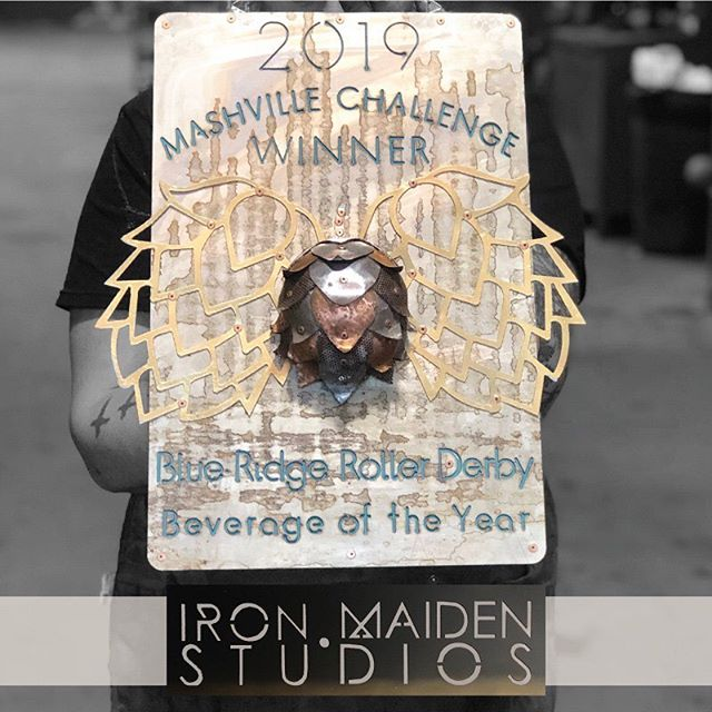 We can't get over how awesome the award is for the best brew this weekend! Made by @ironmaidenstudios and our beloved Pocahotmess (aka Messy)! Who do you think will win this and have the privilege of claiming Blue Ridge Roller Derby's 2019 Beverage of the Year title!? @hiwirebrewing @hillmanbeer @urbanorchardciderco @oneworldbrewing @bhramari_brewingco @uscellularcenterasheville  #mashvillechallenge #exploreasheville