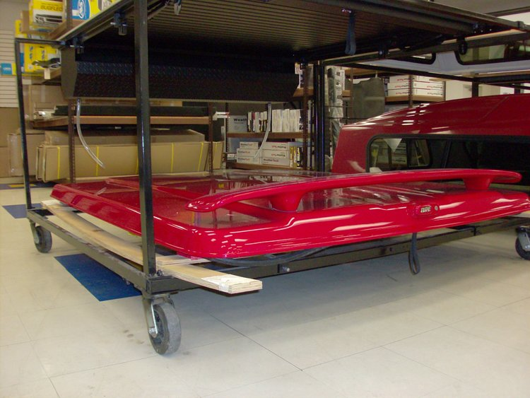 N3487087 - A.R.E. LS2 series for a 2014-Current Chevy extra short bed. Paint code is 9260 Red. Foss lining and sport wing.