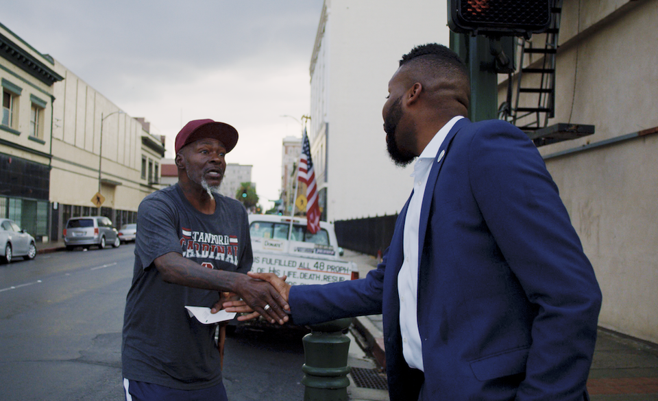 Stockton Mayor Michael Tubbs meets with a citizen in downtown Stockton, CA. MONIKER MEDIA
