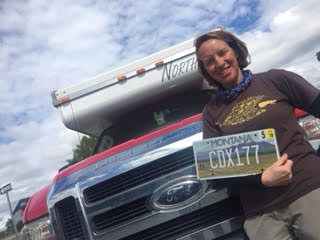 Jane  with her mountain-backgrounded license plate