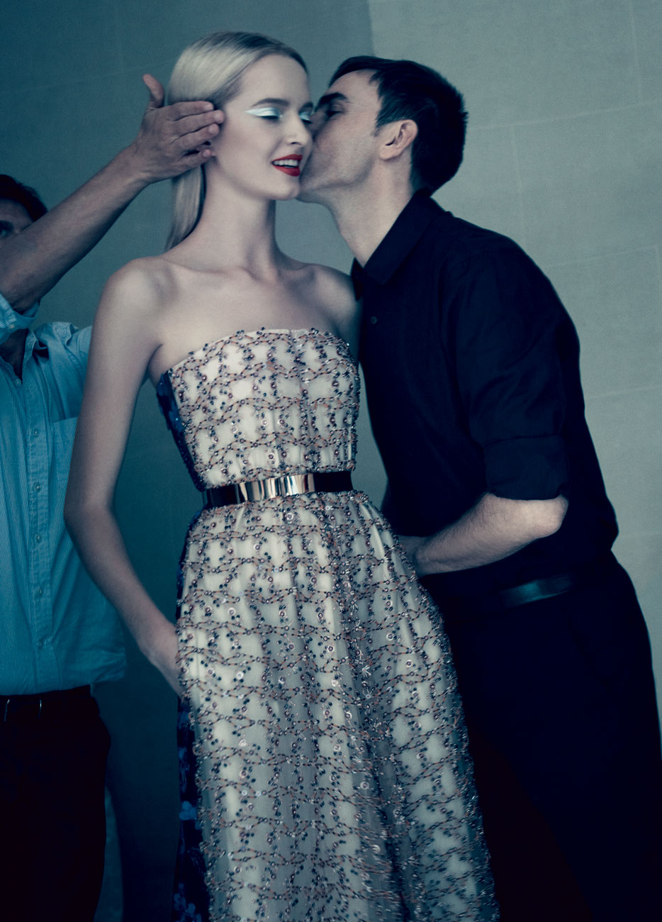Raf Simons kisses a model good luck before his first fashion show for Dior