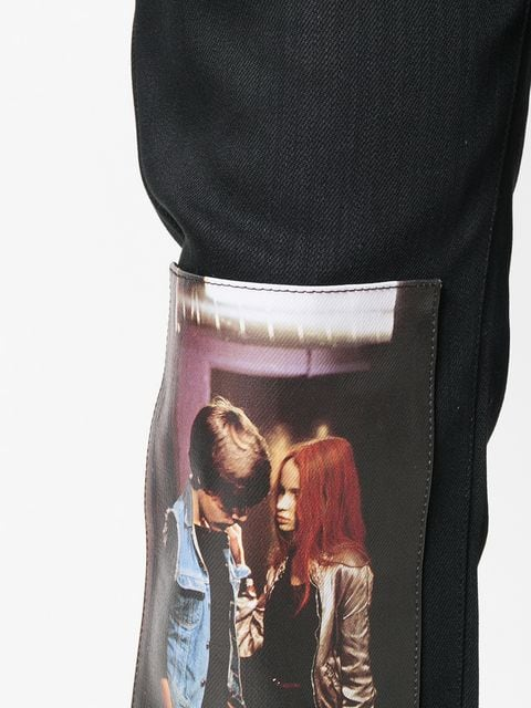 Pants from Raf Simons' AW18 collection with picture of  Natja Brunckhorst and Thomas Haustein  as Christiane F. And Detlev R. in the Biopic of Christiane F.'s life picture taken from farfetch.com