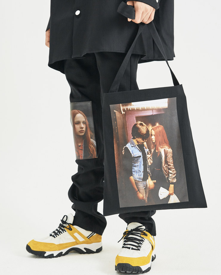 Tote from Raf Simons's AW18 collection with picture of  Natja Brunckhorst   and Thomas Haustein  as Christiane F. And Detlev R. in the Biopic of Christiane F.'s life picture taken from machine-a.com