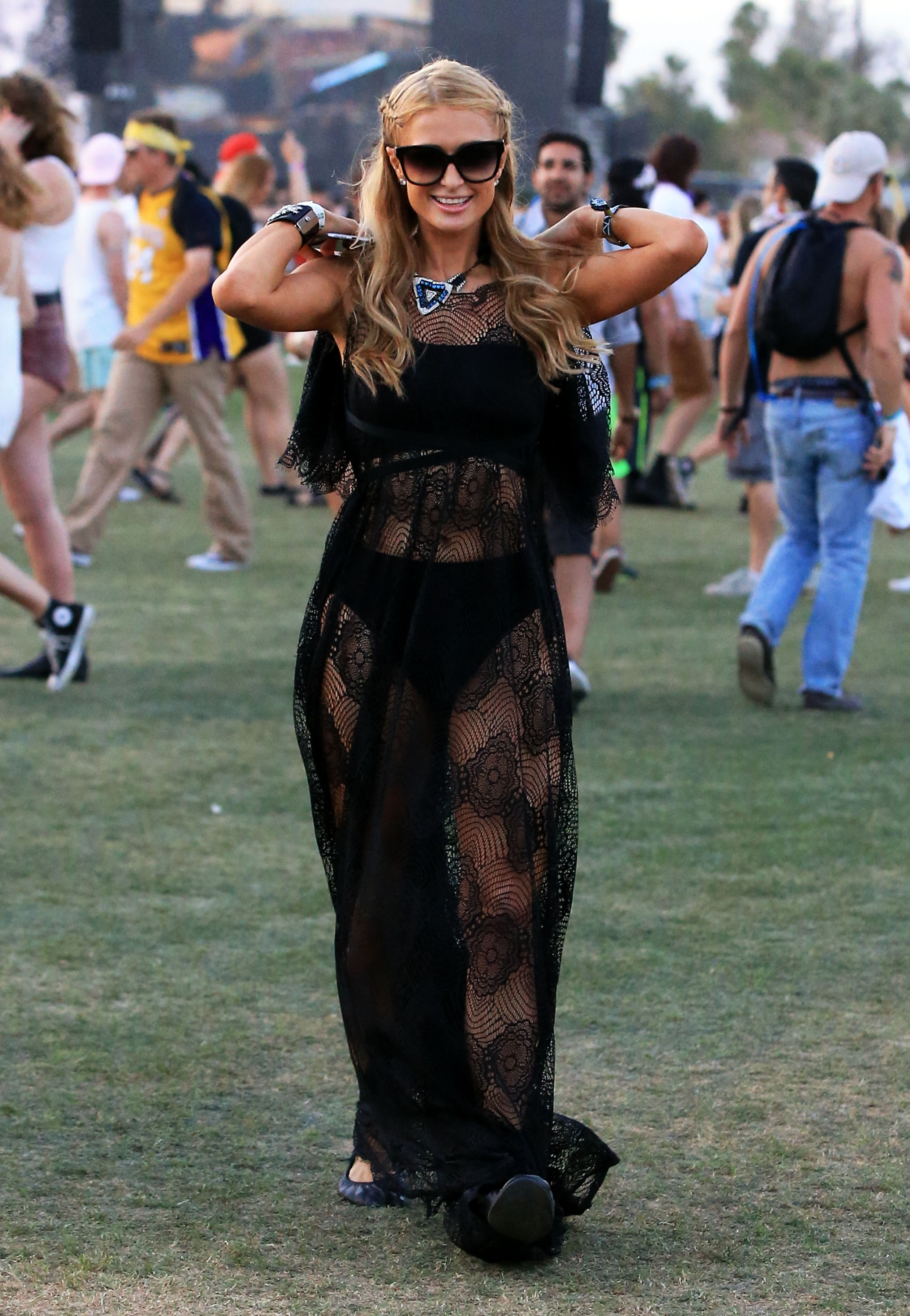 Paris Hilton: Never does she simplify it! She brings the wow factor to everything, demonstrating it here at Coachella she rocks this stunning bohemian style dress that is absolutely breath-taking.