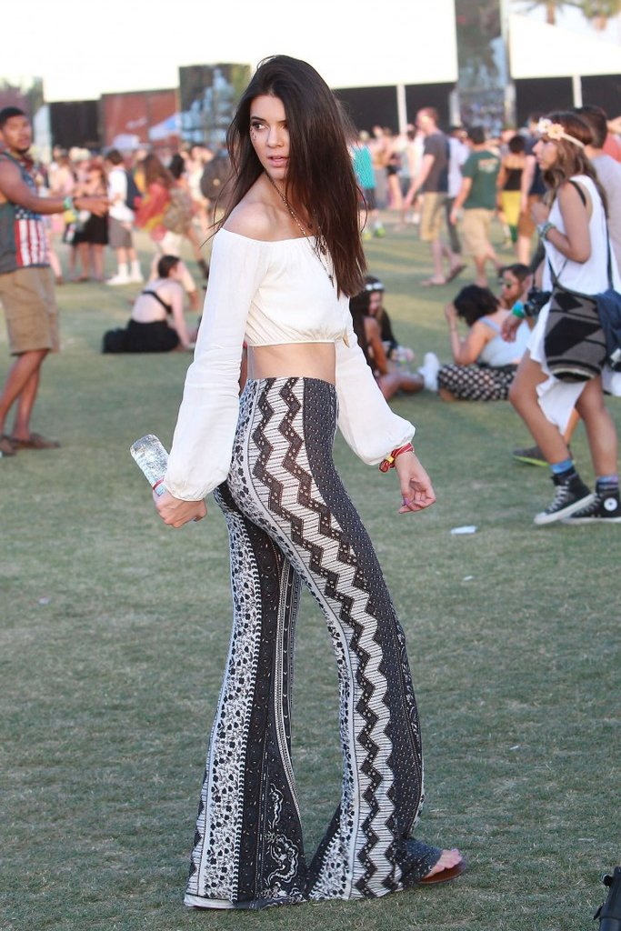 Kendall strikes again: Pair some funky flares with a cropped off the shoulder top and you've created the perfect Coachella look!