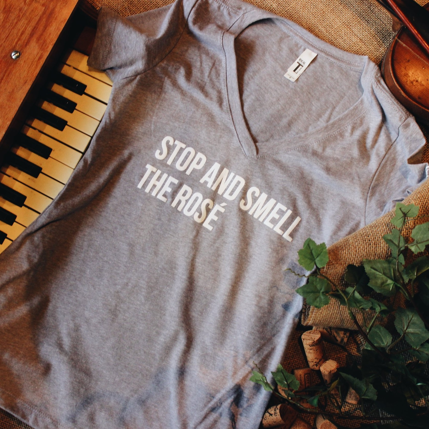 STOP AND SMELL THE ROSÉ WOMEN'S T-SHIRT - Ladies, we know you word hard. You deserve a break. Throw on your sweats and our