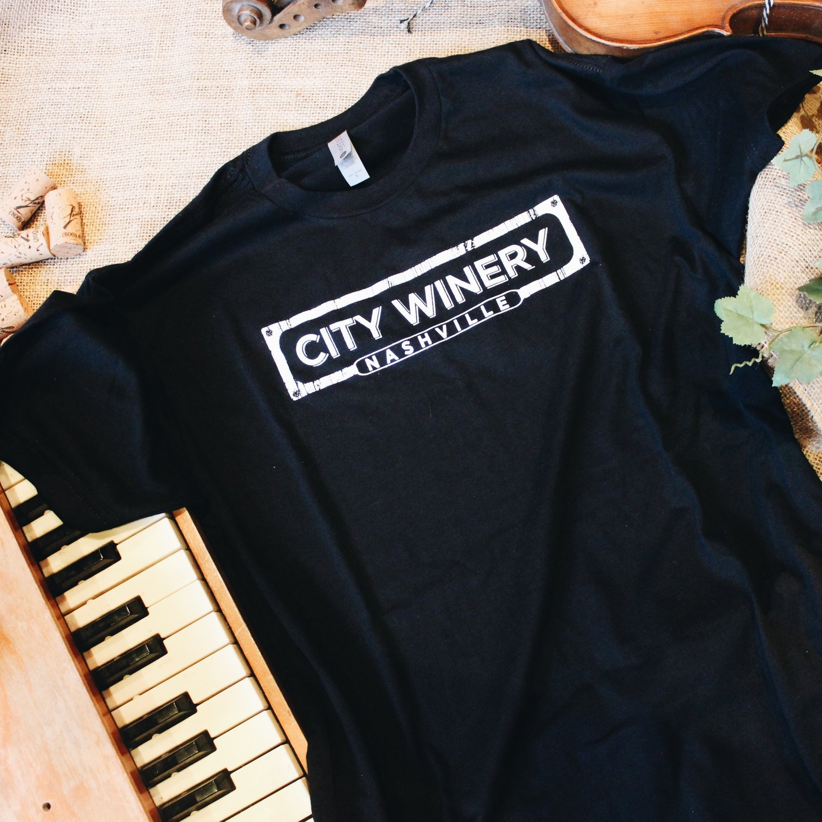 Nashville Logo Black T-Shirt - Rep your favorite location of the City Winery brand with this comfortable, relaxed cotton t-shirt with a rounded neckline and short sleeves. Fits true to adult sizing.