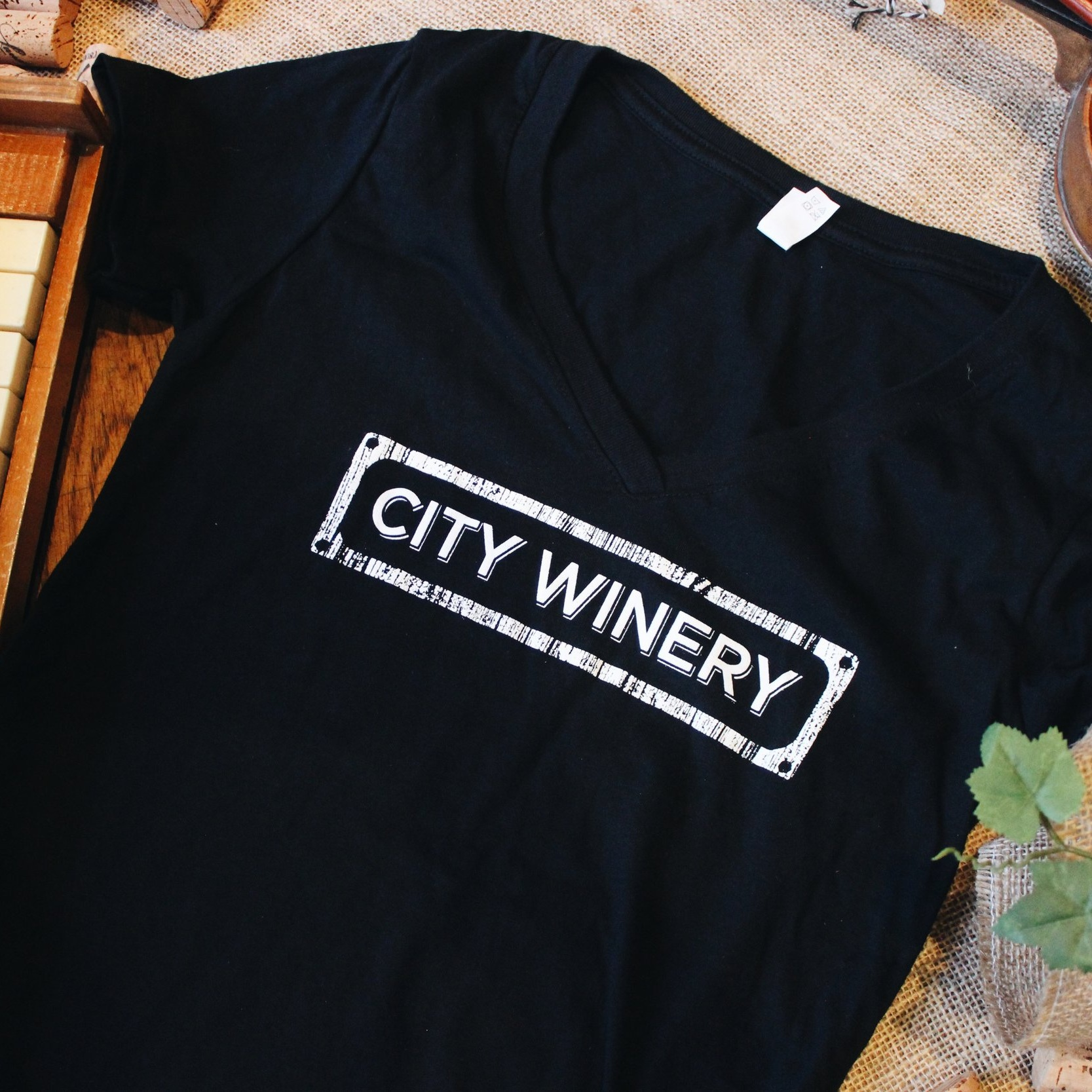CITY WINERY LOGO BLACK T-SHIRT - Rep the City Winery brand with this comfortable, relaxed cotton t-shirt with a rounded neckline and short sleeves. Fits true to adult sizing.