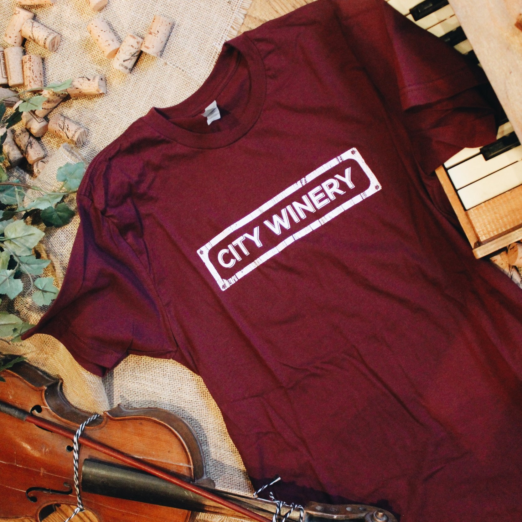 City Winery Logo Red T-Shirt - Rep the City Winery brand with this comfortable, relaxed cotton t-shirt with a rounded neck, red wine color and short sleeves. Fits true to adult sizing.