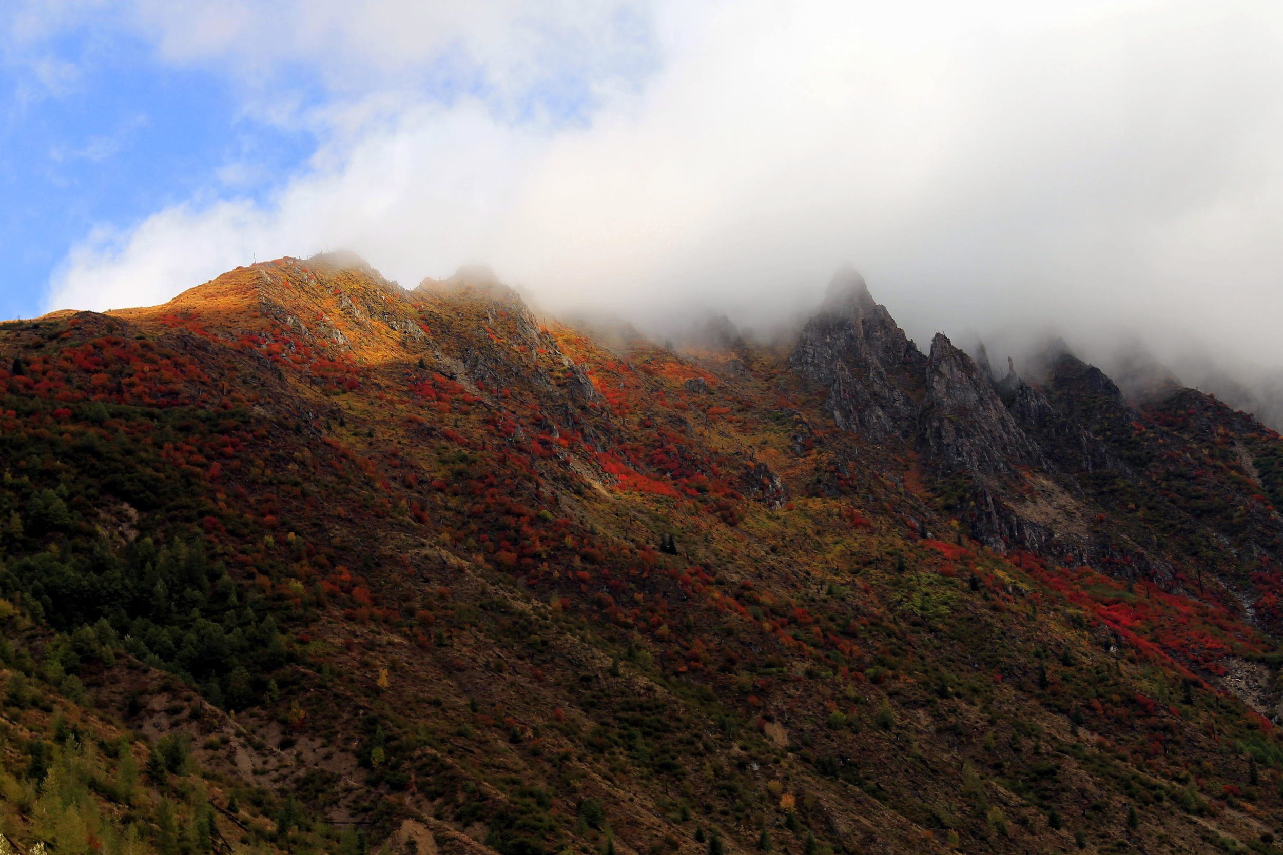 Fall color on the peaks above Coldwater Lake.