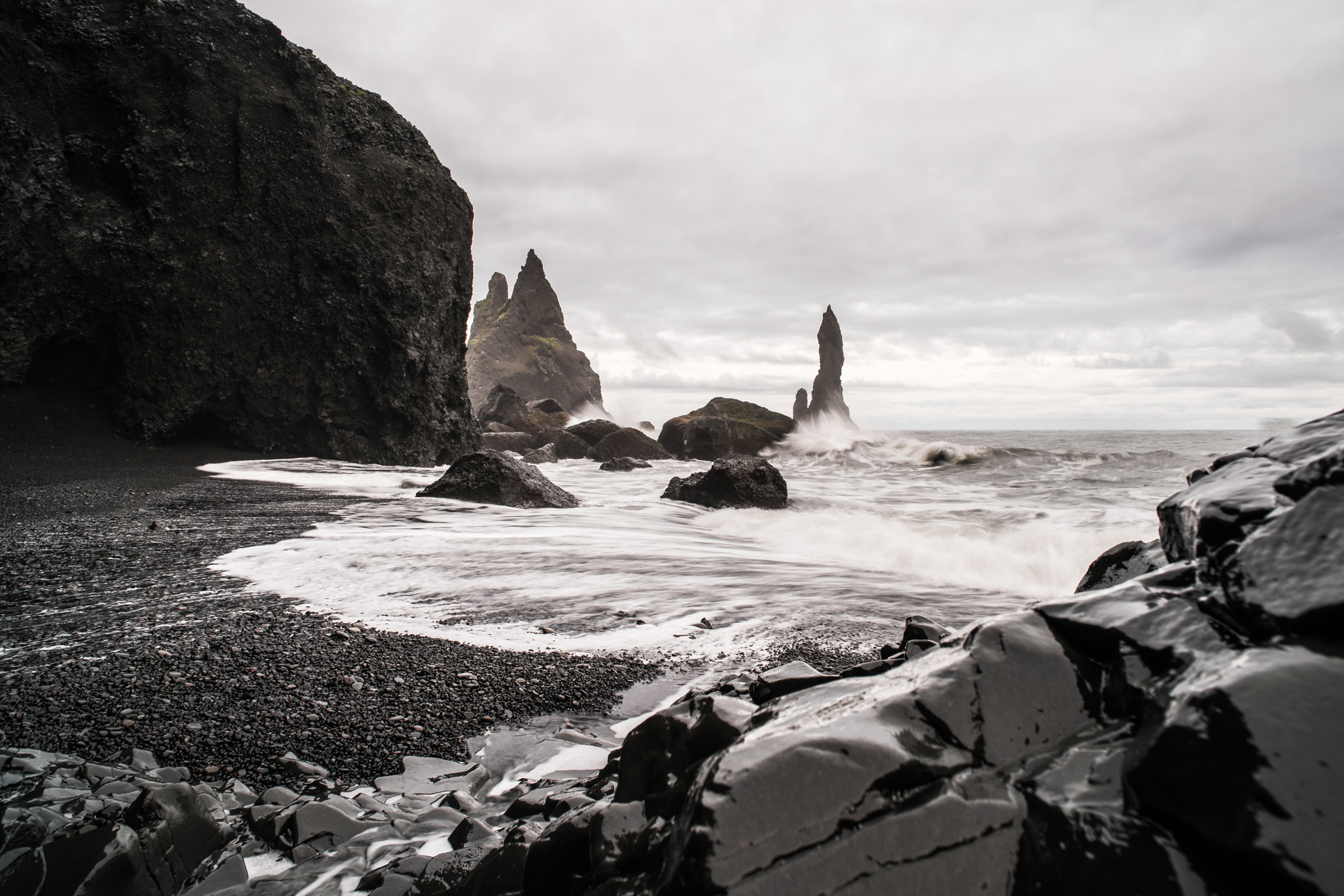 This isn't black and white — you can tell if you look closely at the rocks in the distance. The saturation isn't even muted. It's from the Reynisfjara black sand beach in southern Iceland, on an awfully grey day. I almost killed my camera getting this shot, resting it on a small tripod atop a rock that kept getting splashed with ocean water. Quick reflexes kept it dry … until they didn't.