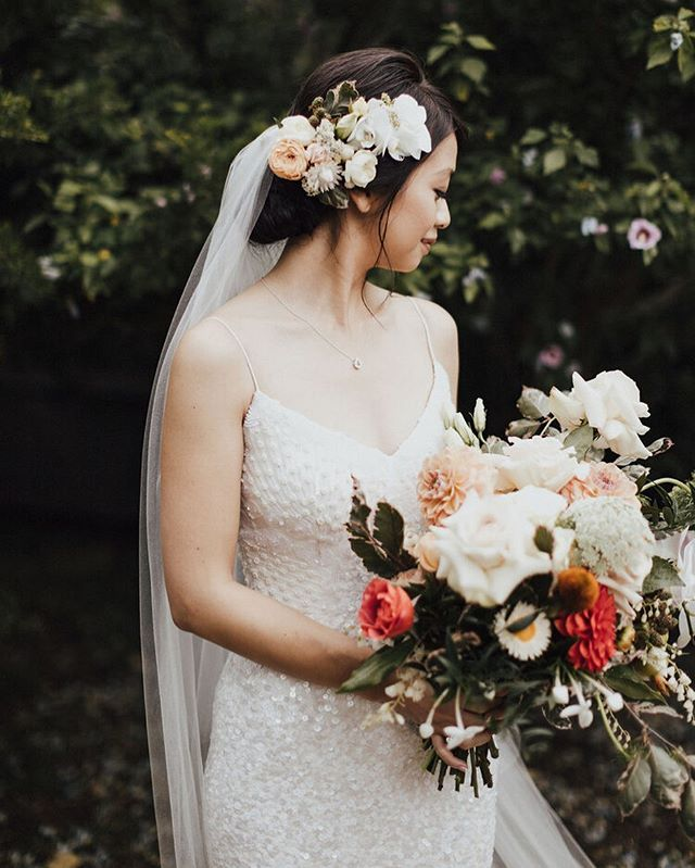 No prettier a bride than Amy with her simple beaded dress and stunningly wild florals.