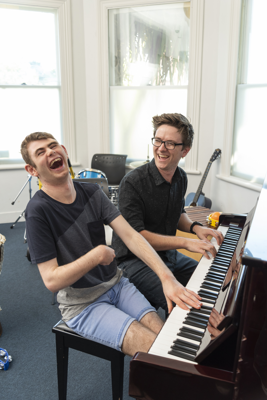 Daniel Olly piano laugh.jpg