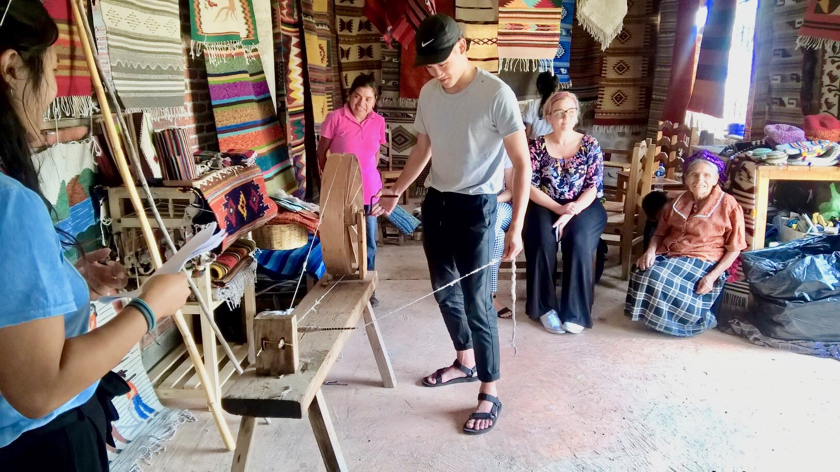 Spinning wool (It's harder than it looks) Teotitlan de Valle, Oaxaca.