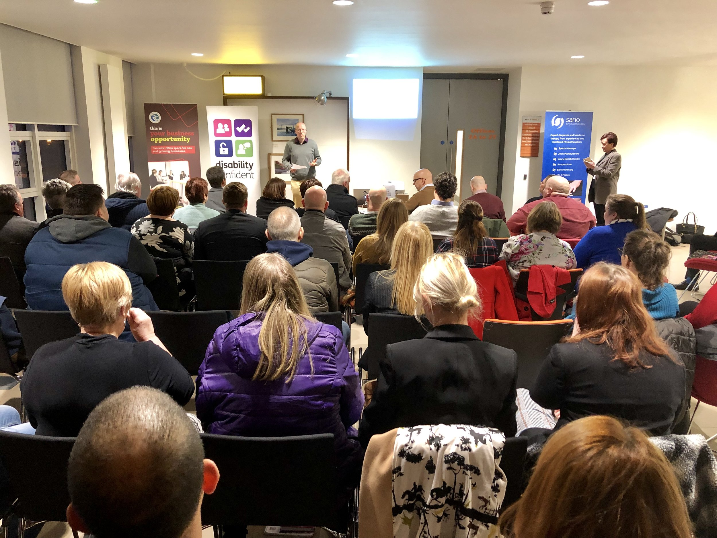 Crowd of 50 Redcar Cleveland business owners talking