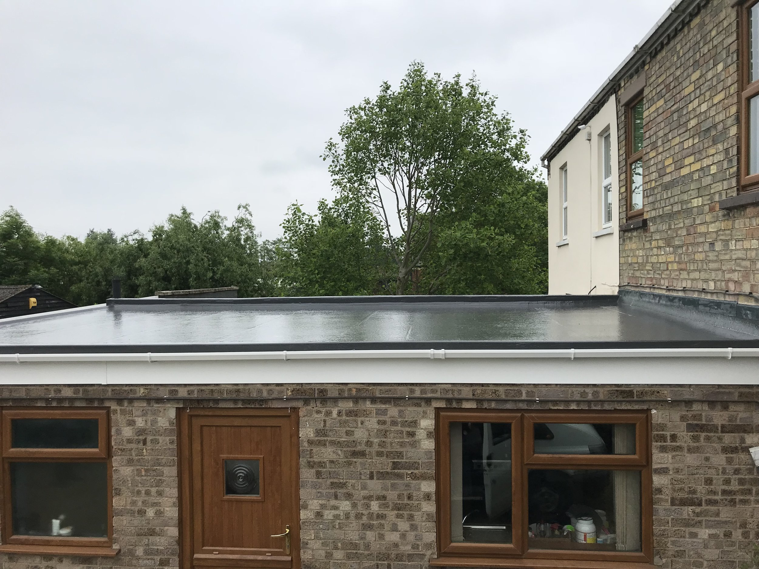Warm Roof Installations - Energy saving Flat roofs, adding comfort and warmth to your living space. All associated fascia and guttering work is included in this service.