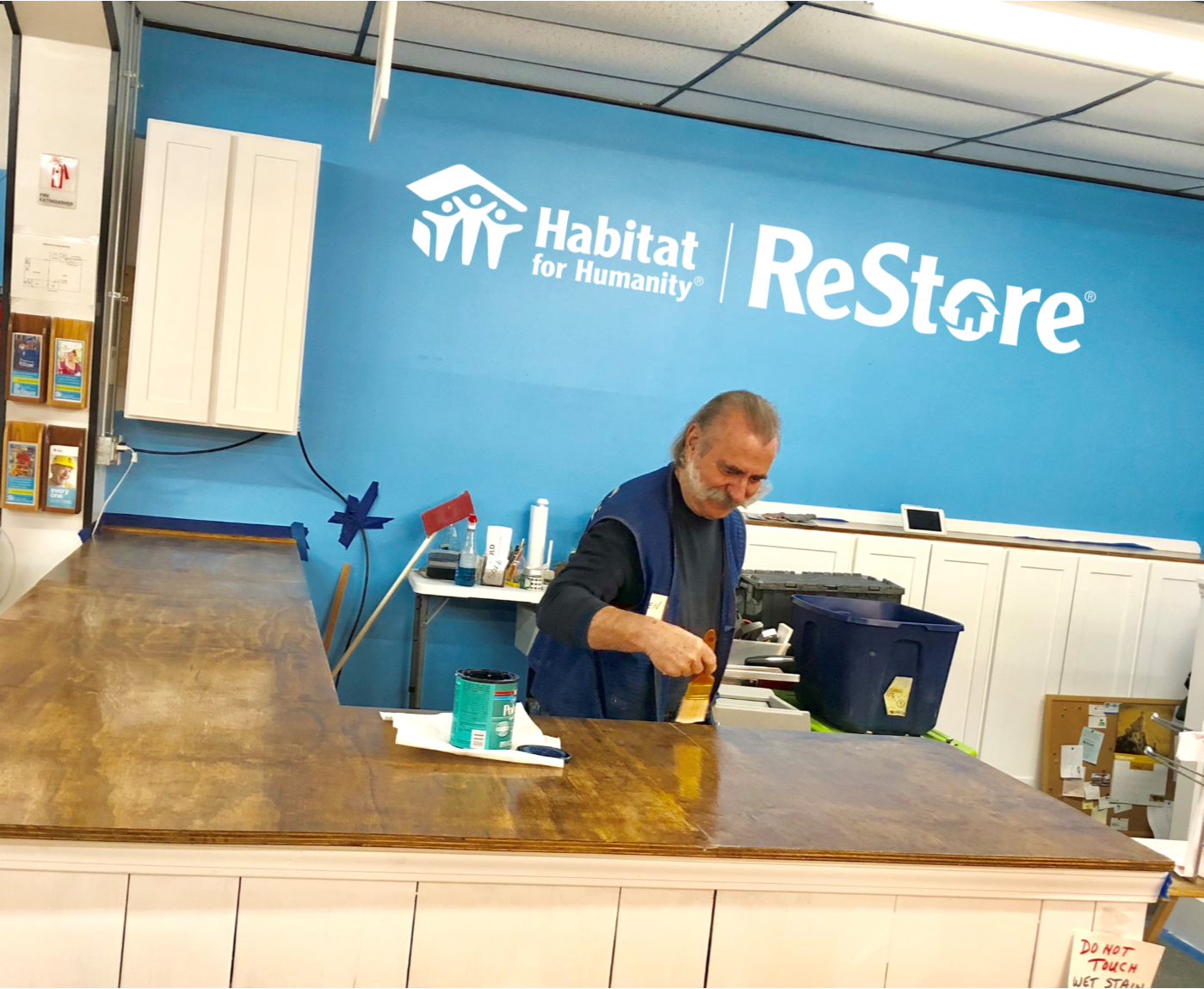 Regular Volunteer Len putting the finishing touches on our new front counter.