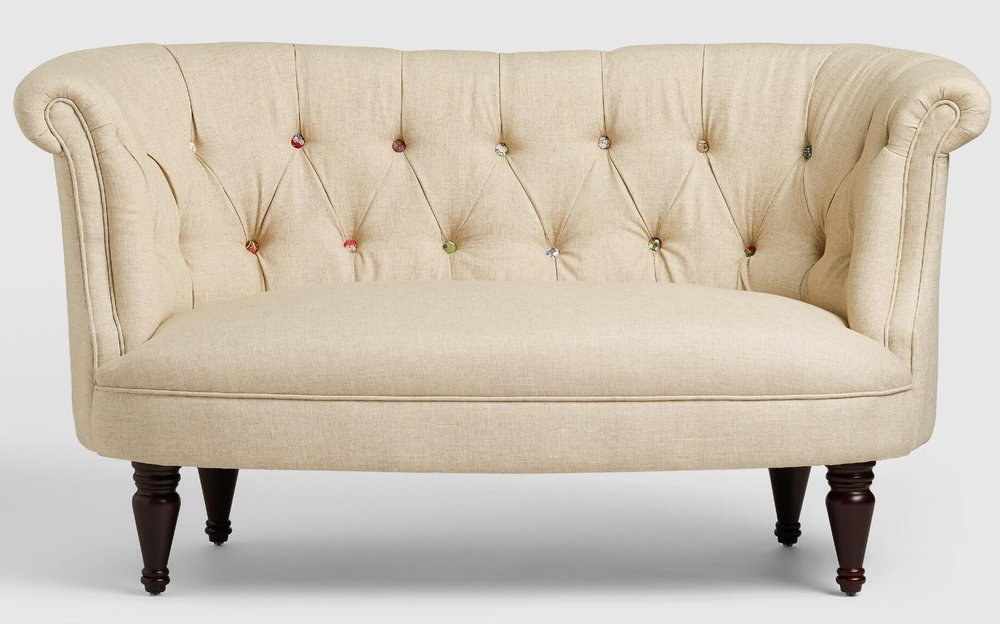 I know I already said I love a tufted sofa, (I really do!) but this one is worth a special mention. Not only does it have a classic shape and design details, but each button is covered in a unique patterned fabric. How cute! It is aptly named the Erin Cute-As-A-Button Loveseat , and is a great investment for your eclectic home at $449. Rumor is that it goes on sale, so keep an eye on it!