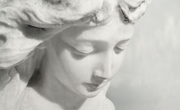 expressive-angel-beautiful-close-up-af-face-marble-sculpture-sweet-expression-looks-down-33977757.jpg