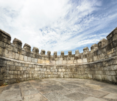 stock-photo-17243183-stonewalled-surrounded-by-wall.jpg