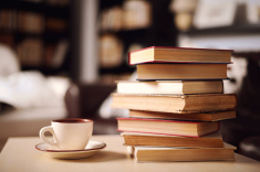 stock-photo-56250936-stack-of-books-in-home-interior.jpg