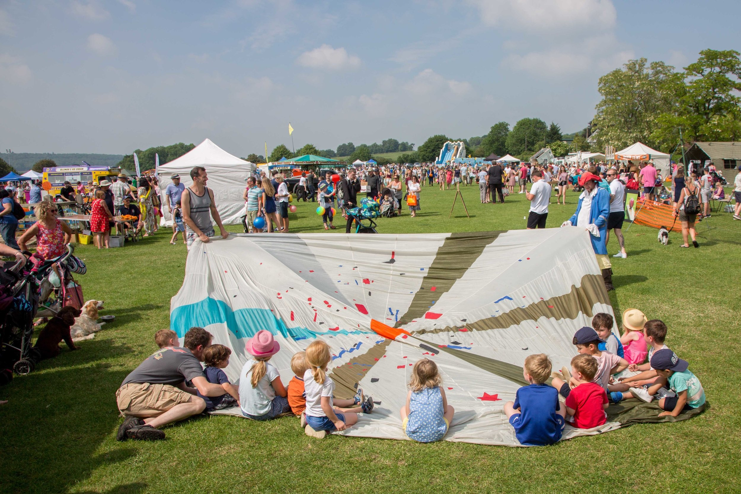 Attractions - The fete is a celebration of the village with stalls from the local societies and artisans, offering great food and drink, all day music and loads of fun rides and attractions for the kids.
