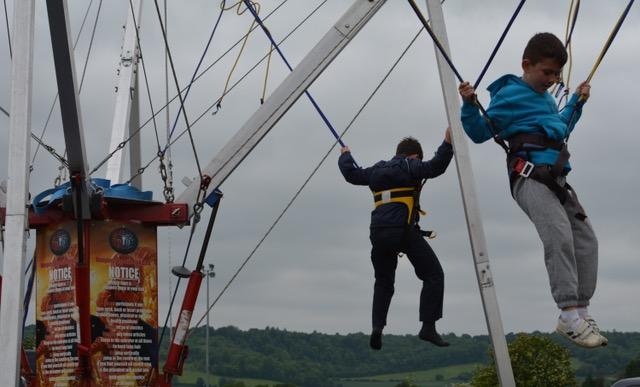 children bouncing on trapeze.jpeg