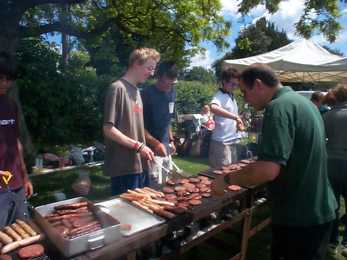 Cooking burgers at scout bbq.jpg