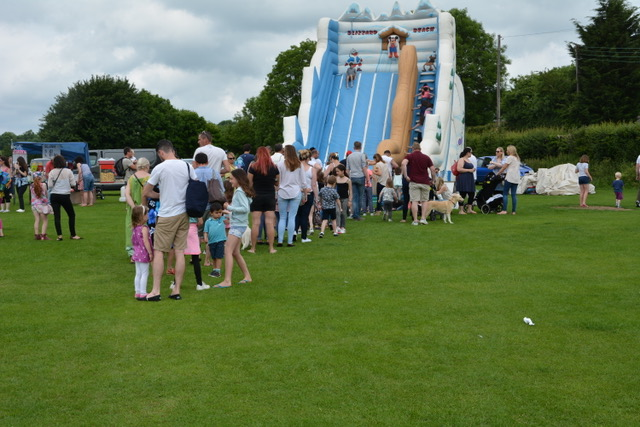 LIning up for the bouncy slide.jpeg