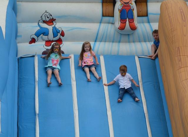 Three kids going down slide.jpeg