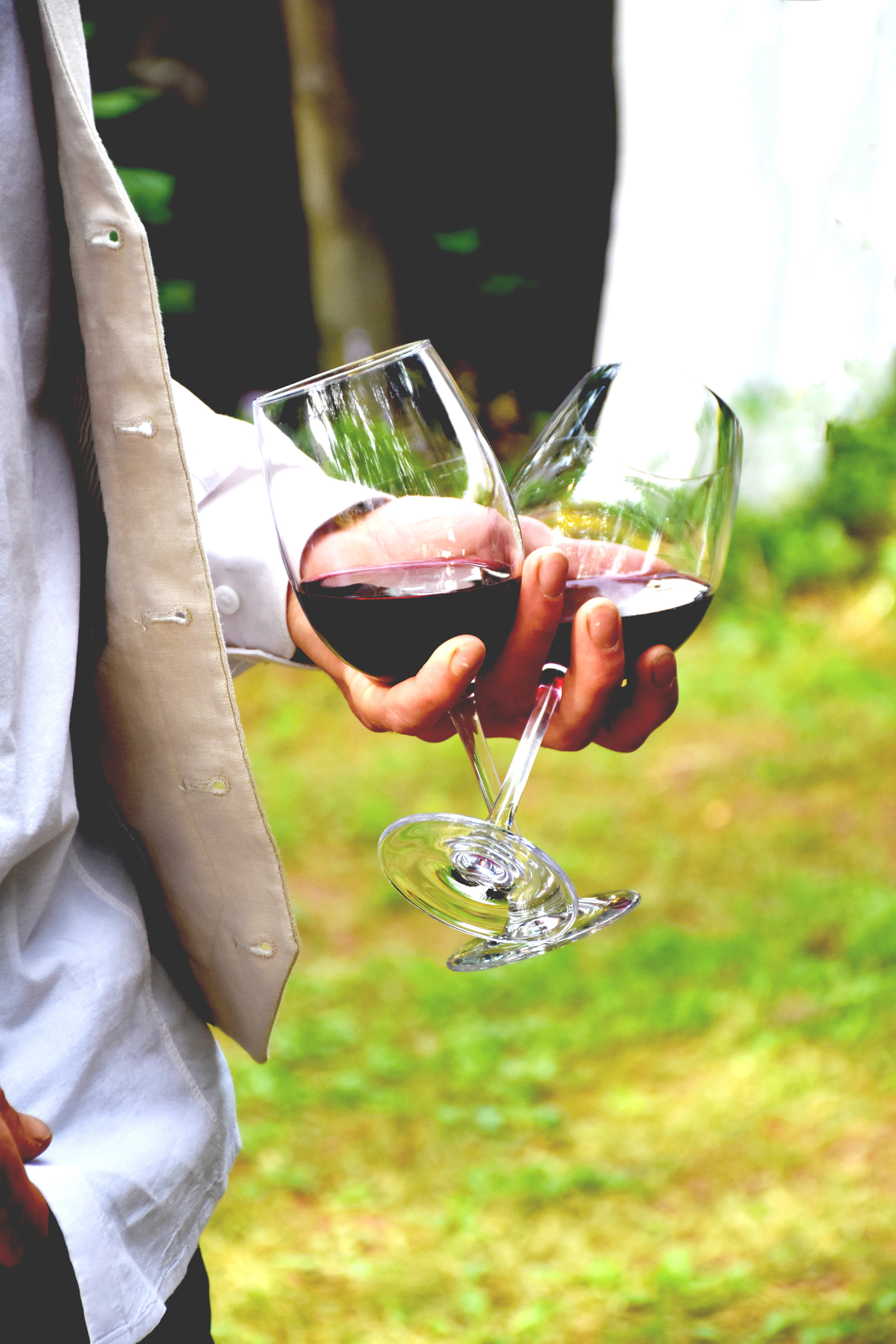 groom with wine glass in hand.jpg