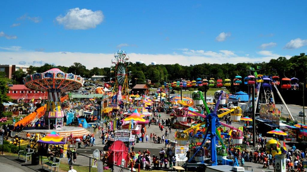 The Great James H. Drew Exposition - A Carnival Midway featuring over 40 rides and numerous games that will surely provide fun for all! All rides require more than (1) coupon each.Ride Restrictions Apply.