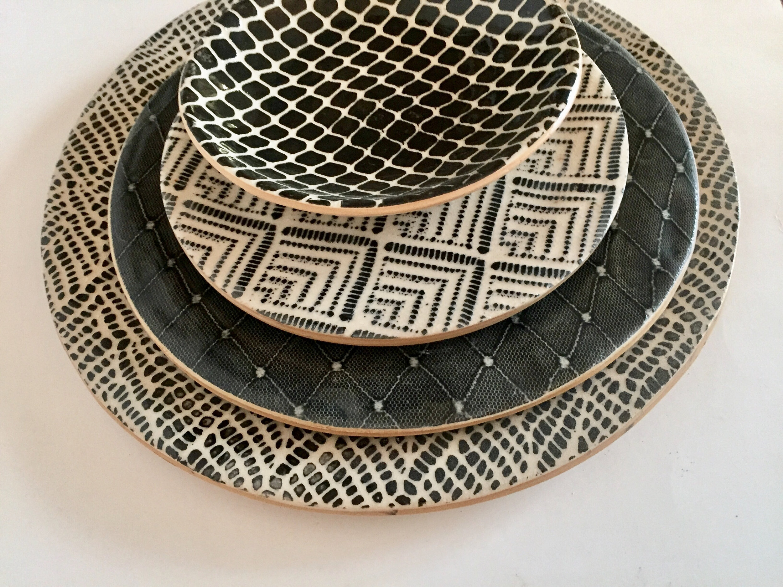 black dinnerware in deco, diamond, and braid_courtesy of Terrafirma Ceramics Inc..jpg