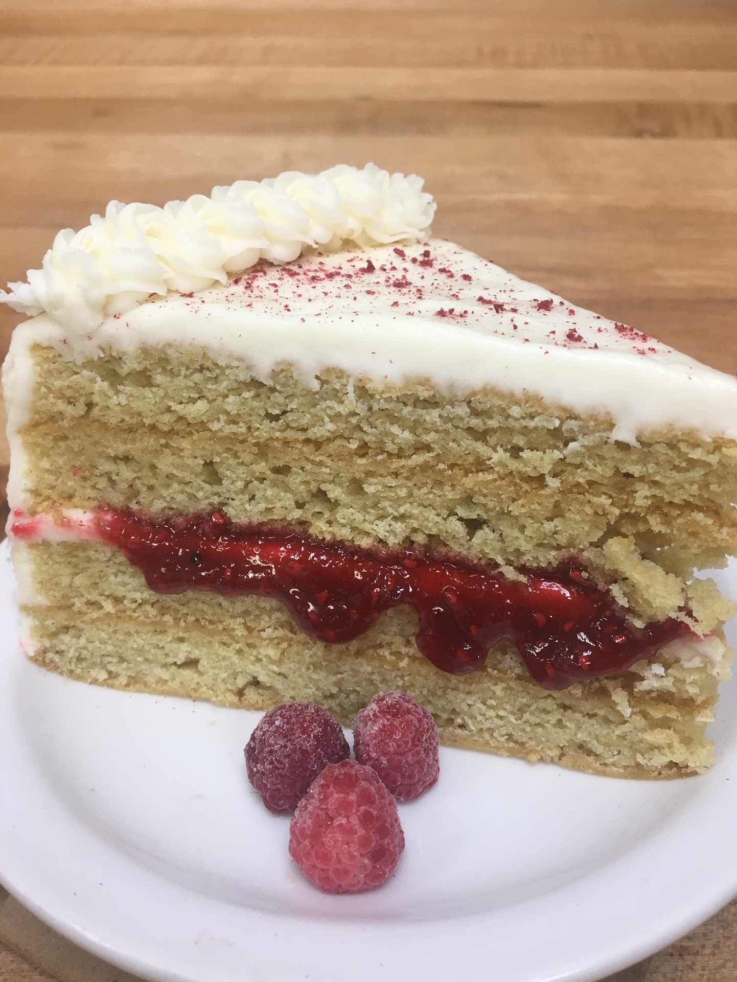 vegan Lemon cake with raspberry filling and coconut buttercream.JPG