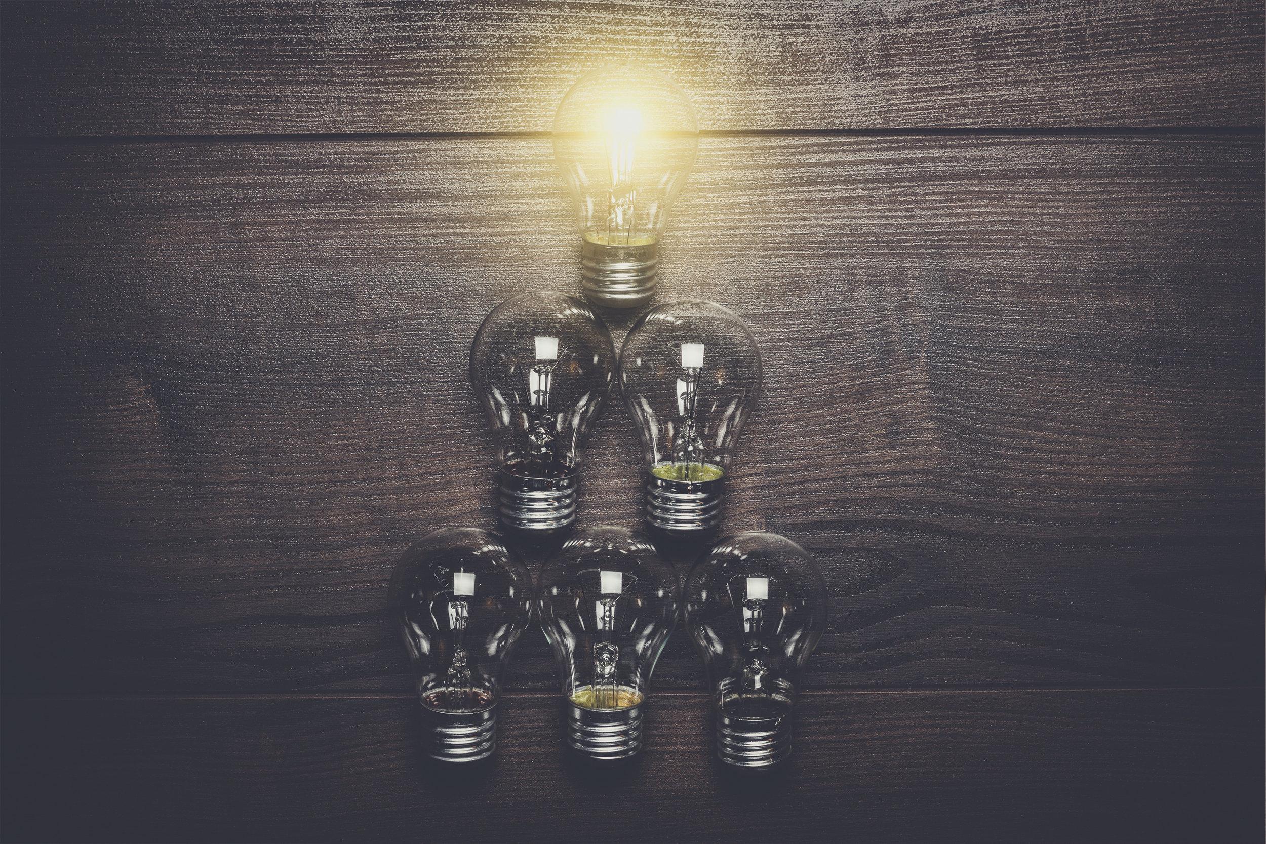 glowing-bulb-leadership-concept-on-wooden-P3EM87M.jpg