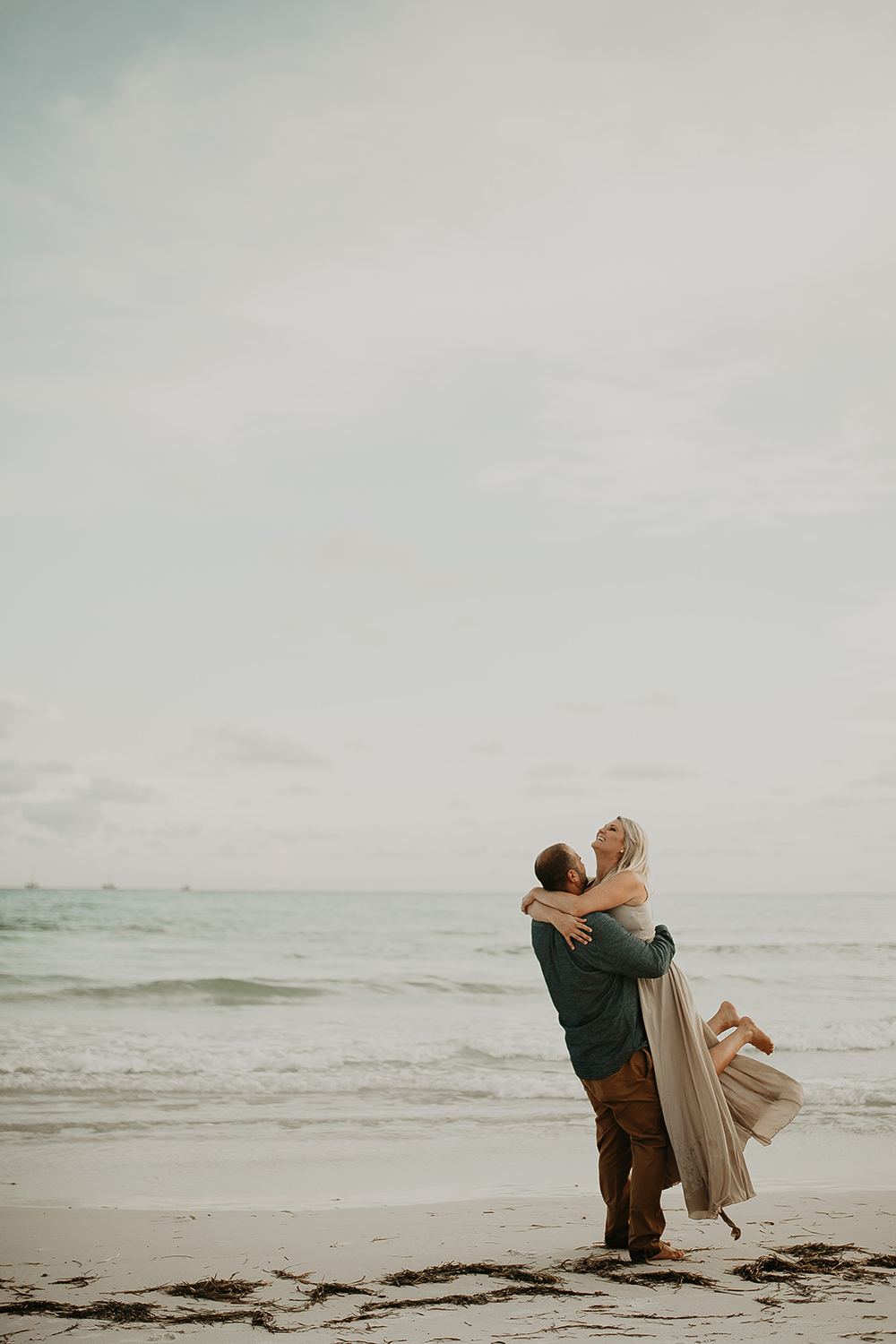 Couple in Love Embracing on the Beach