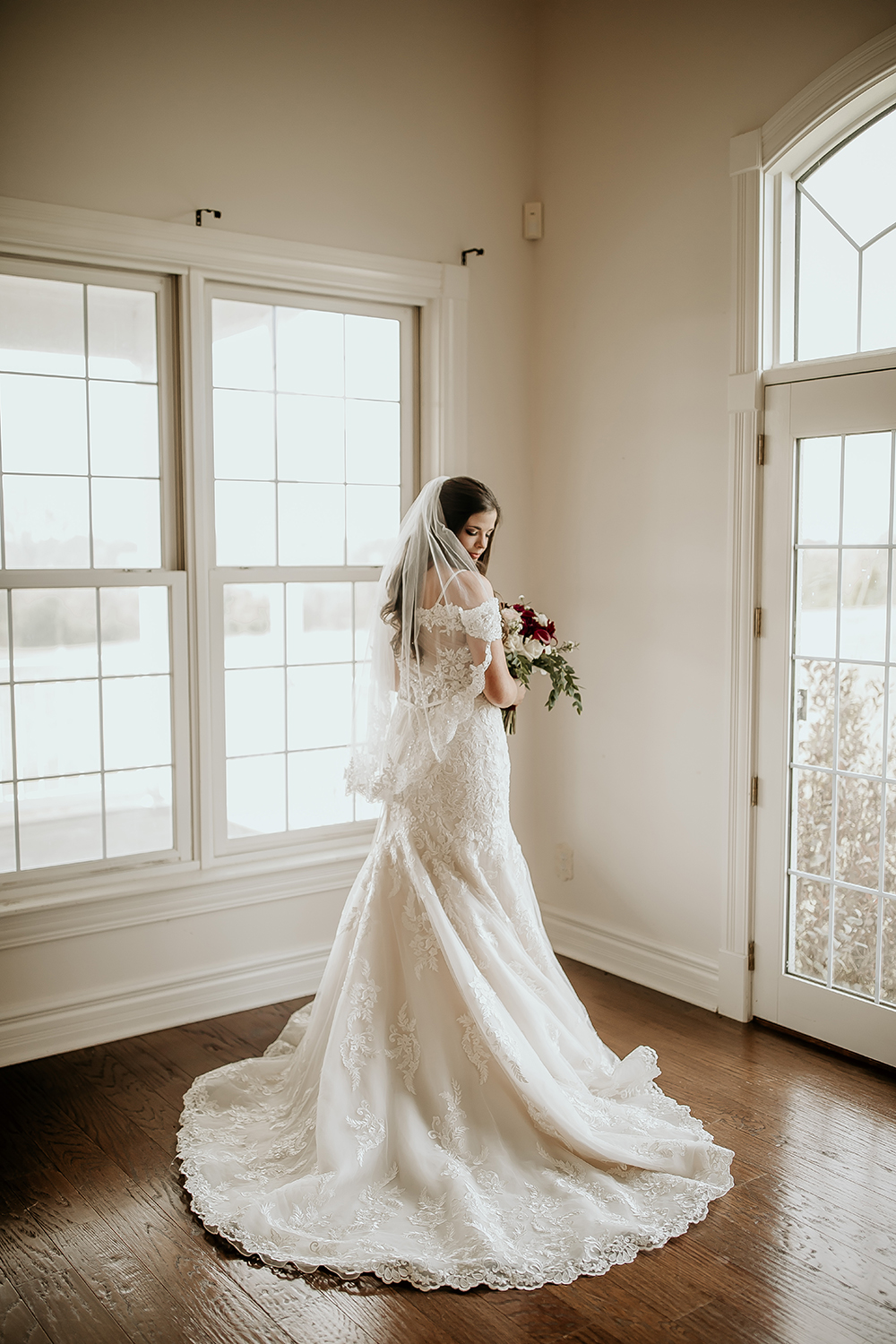 Bride in a Classic Lace Wedding Gown and Veil