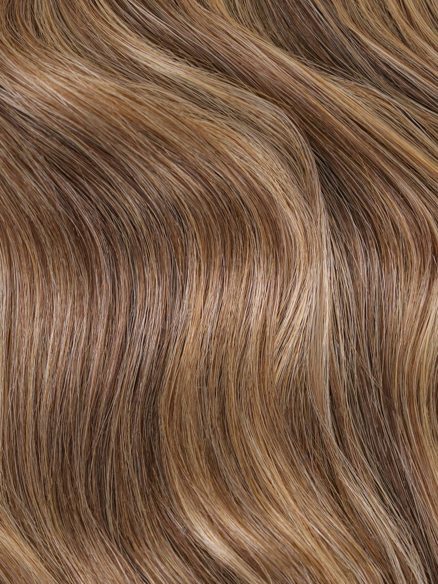 Chestnut Latte Highlights #640 - A blended combination of a toned down warm brown and golden blonde mesh together to create more depth and dimension.