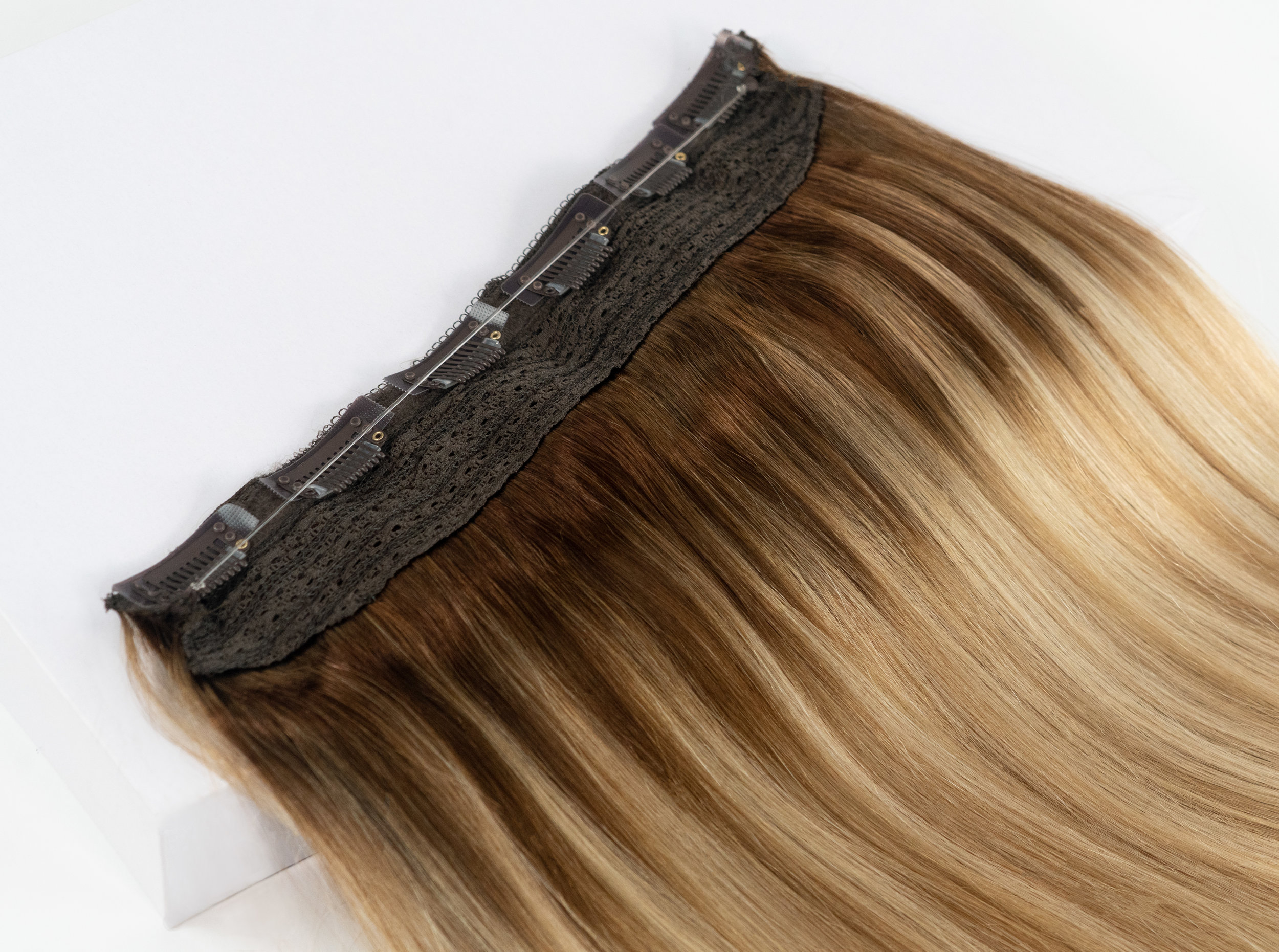 Joi Veil (Halo-Style) - Using a transparent string that will blend seamlessly with the layers of your own hair, this halo-style extension piece is a one-step wonder to length and volume.