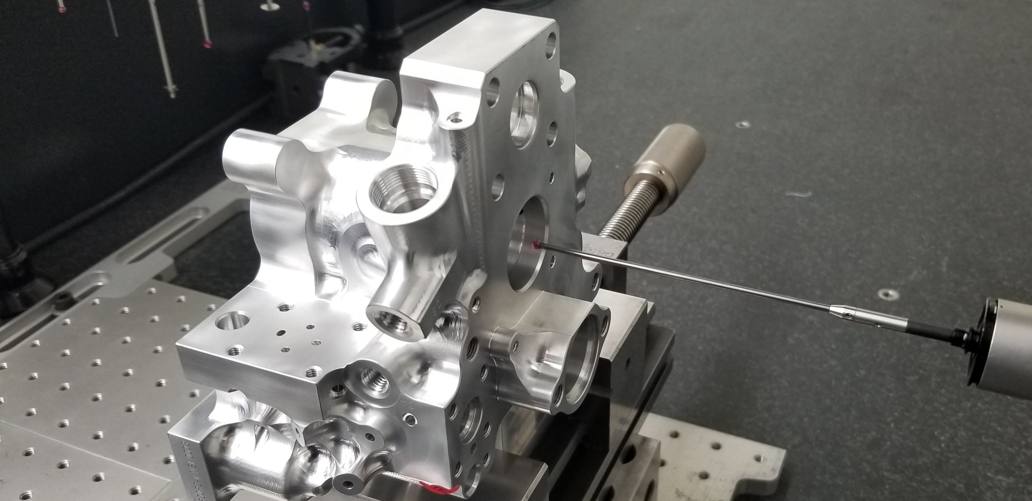 Two of our CMM's have an articulating head and can move in 7.5° increments. This allows us to check at least 5 different sides of a part during one program.
